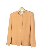 This luxe washable heavy weight 100% silk crepe round neck full lined jacket side pockets is a little shaped.  A good fitted and a little structured look jacket for early fall and beyond.  This jacket has a vest to match.  See pictures below.   
