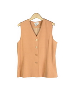 This luxe washable heavy weight 100% silk crepe V-neck fully lined vest is a little shaped and fitted.  This vest matches all the blazers and jackets in this group. See other styles pictured below. 