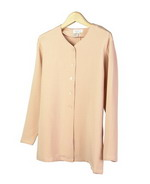This luxe washable heavy weight 100% silk crepe V-neck unlined long sleeve shirt jacket is perfect for early fall and beyond.  Clean sewn hem and cuffs.  It is as comfortable in the office and meetings as it is out for dinner and party.  The clean shaped design works easily with your favorite jewelry.  Side slids to give an relaxed look. This shirt jacket matches the tank, trousers and long skirts in this group pictured below. 