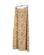 This medium weight washable 100% silk crepe-de-chine long skirt with prints in chestnut brown shade is perfect for early fall and beyond.  Back waist has partial elastic for easy fit.  It is as comfortable in the office and meetings as it is out for dinner, party and travel.  The prints can work well with fall colors in chestnut, oatmeal and warm taupe shades.  This feminine soft skirt with prints can matche the chestnut solid color jackets and shirts in this group.  Handwash cold and hang to dry; or dry clean. 
