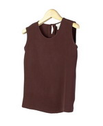 This luxe washable heavy weight 100% silk crepe sleeveless shell is a little shaped and fitted.  The shell in this heavy weight silk is an appropriate young looking layering pieces for the fall season.  Great for work and everyday wear.  The silk shell matches the jackets, shirts, trousers and long skirts in this group pictured below.  Or it can work with the suits you might already have.  Handwash cold and hang to dry; Or dry clean. 7 colors available for this sleevless shell.
