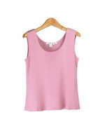 This 100% silk knitted tank top has a natural stretch that provides a comfortable fit and easy movement. It matches all of Composition's full-needle silk v-neck and jewel neck cardigans, making fashionable sets. This tank works perfectly with suits, jackets and blazers; it is great for work, travel and leisure wear. Offered in many colors available in stock.
