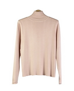 This ladies 100% silk turtleneck sweater long sleeve is made in fine gauge full-needle knit. The silk pullover top has a natural stretch so it provides comfort and easy movement and it works well with suits, jackets, and blazers. This turtleneck sweater is our customers favorite fine knit top for the fall and winter seasons. It is great for work, travel and leisure wear; a luxurious basic silk sweater to you'll love for years. The ladies turtleneck is offered in sizes from S (6) to women's plus size 1X(16W-18W). 