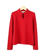 This silk/cotton/cashmere/lycra blend long sleeve knit blouse is made in 14 gauge flat knit.  It has a double-layer collar and has a front key-hole design.  The top layer is a cashmere blend and the bottom layer is satin shine viscose knit for the collar and the cuffs.  The subtle contrast of the double-layer texture makes this knit blouse look contemporary and sophisticated.  A great fall/winter knit blouse.  The top drapes nicely and gives a comfortable fit and slim look.  This blouse has a matching knit skirt to complete a great looking set.  (See pictures shown below).  Available in sizes S(4-6) - XL(16).