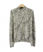 Compositions' silk cotton cashmere mock neck sweater is a beautifully designed fine knt top that is ideal for the fall and winter seasons. The tone-on-tone floral prints sweater gives a suble and an elegant look. The gradation of the colors allow you to have the sweater to match many gray or black jackets, skirts and pants that you might already have. You'll love our floral knit sweater for its elegant prints, luxurious look, and flattering fit. This pullover is perfect for dressing up as well as for dressing casually and comfortably. Hand-wash or dry clean for best results.