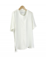 Washable silk shirt in round neck short sleeve with mini-button front style.   Softly shaped and light weight with great draping.  Relaxed fit with side slits.  Machine wash or dry clean.