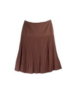 The full fashion pleated knit skirt is made of viscose nylon crepe yarn with stretch of lycra.  The pleats are created from the needle work.  It is an easy-care pleated skirt and can match all types of tops and jackets. The clear pleats of the knit do not need to be ironed or pressed.  After wash, a little steam will bring back every clear pleats.  It is an easy-care full fashion pleat-skirt.  Hand wash cold and lay flat to dry or dry clean.  
