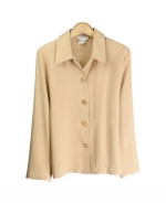 This 100% spun silk unlined shirt-collar jacket is comfortable, soft, and versatile. You'll want to wear this jacket for the entire transitional and fall seasons. This stylish shirt-collar jacket can work beautifully with any of our silk sleeveless shells, t-shirts, and sweaters. Our jacket is perfect for dressing up as well as for dressing down. This jacket matches the sleeveless shell, pull-on pants and the long skirt in this design collection. Hand-wash or dry clean for best results.