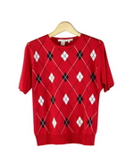 Women's 100% silk sweater jewel neck short sleeve is made in 14 gauge fine knit jacquard argyle pattern on the front of the sweater. (Back side is in solid color). This argyle pattern is a hand-machine weaved jacquard pattern, which makes the sweater especially precious. Great draping.  The tri-color jacquard sweater matches beautifully with the argyle line pattern cardigan SC341 to make a sweater set.  Limited quantity.