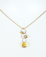 Complete your outfit with this elegant gold-tone necklace. Small gold jewels hang off each circle link. A unique and delicate piece.