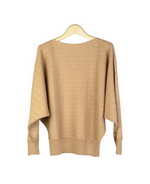 This women's silk cashmere sweater in deep dolman sleeve pullover design is beautifully made of 85% silk and 15% cashmere. This stylish sweater top has a cable pattern front and back. The sweater has a loose and relaxed look; the deep dolman sleeves give this pullover a stylish look and comfortable fit. Dry clean or handwash cold and lay flat to dry. Steam the sweater to bring the original softness of the good hand-feel.