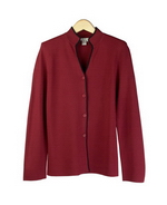 This viscose nylon mandarin collar long sleeve knit jacket is flattering and beautifully shaped. Dry clean or hand wash color and lay flat to dry. Steam or press with steam to maintain the great texture of the knit jacket.