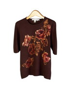 Floral prints on ultra chashmere-soft 100% fine knit short sleeve jewel neck sweater.