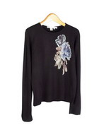 Floral prints on ultra cashmere-soft 100% acrylic fine knit long sleeve jewel neck sweater.  Hand wash and lay flat to dry or dry clean. Great for all occasions.