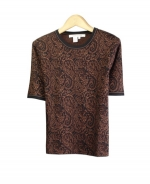 Our silk cotton short sleeve top is a fine jacquard knit. This short sleeve is a jewel neck top which matches all the knit jacket in this paisley design collection. It is great for all occasions. Hand wash or dry clean for best results.