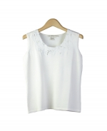 This beautiful silk nylon small scoop neck sleeveless shell is engraved with a gorgeous classic embroidery. It is a beautiful top for dressing-up and dressing-down as well. Great for all occasions. Hand wash or dry clean for best results. 